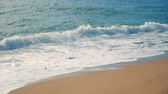 emerald water : Sandy beach is being washed by the sea waves. Slow motion. Stock Footage