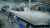 purificado : Glass bottle are getting stacked together and slowly relocated Stock Footage