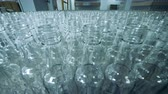 licor : Plenty of unfilled glass bottles in a factory