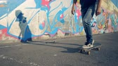 grafiti : Skateboarding process of a young man carried out outdoors