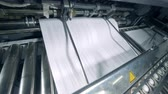 printshop : Issuing of printed paper onto the rolling conveyor