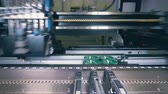 inventário : Factory machine is making electronic boards