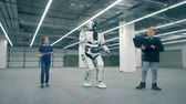 inovador : Children with computers are controlling a cyborg and walking with him Stock Footage