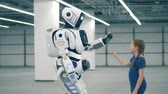 droid : High-five gesture of a little girl and a robotic humanoid