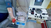 инъекционных : Modern machine works in a transfusion center, pumping blood.