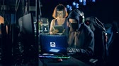 virussen : A female and a male hackers are breaking into servers