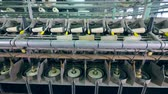 konular : Modern textile plant machines working with white threads and spools. Stok Video