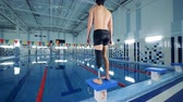 스트레칭 : Man with artificial leg stands near a pool while training.