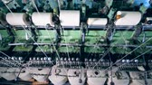 katoenplant : Industrial machine is unwinding sewing spools. Textile factory equipment. Stockvideo