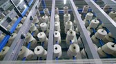 slierten : Top view of reels with white threads being static. Garment factory production equipment. Stockvideo