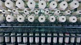 ウィーブ : Tailoring process carried out on an industrial machine with spools in a textile factory. 動画素材