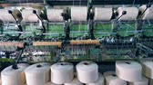 slierten : Sewing bobbins with reeling white threads. Garment factory production equipment. Stockvideo