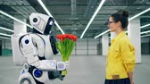 sintético : Human-like robot is giving flowers to a young woman Vídeos