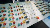 spia : Lights and buttons on a console board. Electrical equipment in a control room at a factory.