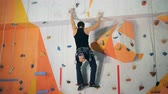 estoque : Male climber is bouldering a wall in an artificial climbing facility