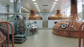 cervejaria : Metal tanks for beer brewing work in a modern facility.
