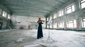 slierten : Abandoned building with a lady playing the violin