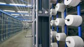 slierten : Many clews rotate on a factory rack, spooling with threads. Industrial Textiles Production Line