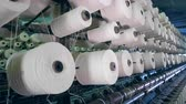 slierten : Many spools with threads spinning on a factory machine. industrial fabric production line