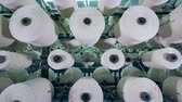 slierten : Industrial equipment rotates clews with fiber in a Industrial textile factory. Stockvideo