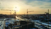 keretében : Cranes located in the building site at sunset