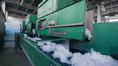Polyester fiber produced at a modern factory, moving on a conveyor. 動画素材