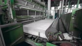 roller conveyor : Factory machines roll a layer of synthetic fabric.