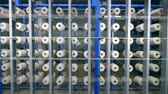 szövés : Plenty of sewing reels attached to the industrial machine. Industrial textile factory