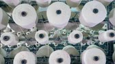 szövés : Spinning bobbins with white threads. Textiles Production Line Stock mozgókép
