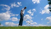 giocoleria : A man is playing tricks with a golf club and a ball