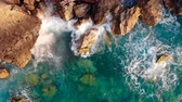 rochoso : Waves splashing against rocks in Greece.