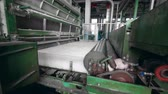 roller conveyor : Factory machines roll polyester fiber on a conveyor. Stock Footage