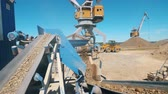 ham : Crushing machine works with rubble at a quarry. Industrial mining concept.