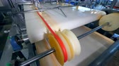 distribution automatique : Edible stripe is getting wound onto the machine