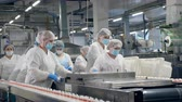 krab : Food factory equipment with women relocating packaged food.