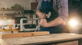 shaping : Carpenter, craftsman working. One person works with wood, shaping it with tools.