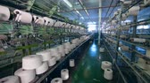 szövés : Garment plant with white threads forming fabric mechanically. Textile factory equipment.