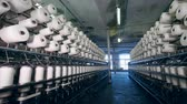 szövés : Plenty of sewing spools in the garment factory. Textile factory equipment.