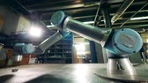 正確な : A robotic arm moves while working with a small gear. 動画素材