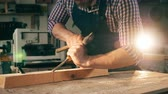 망치 : Wood is getting processed manually by a craftsman. Craftsman working in carpentry.