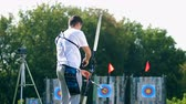 flechette : Bowman is preparing his bow and shooting from it Vidéos Libres De Droits