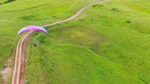 paragliding : View from above on a person flying the parafoil. Extreme sport concept. Stock Footage