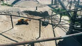 groeve : Mining yard with vehicles excavating and relocating gravel Stockvideo