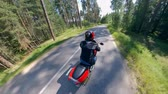 motocyklista : Motorcyclist is driving on a high speed along the road