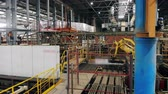 自動化 : Industrial automated machine moves boxes in a industrial facility. 動画素材