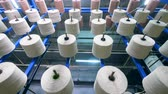 tekercs : Textile industry concept. Process of threads coiling onto bobbins at a textile factory.
