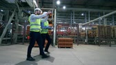 renovovat : Industrial plant unit with two inspectors walking along it