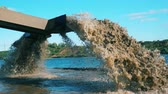 groeve : Barge with splashing water on a sand extraction site. Stockvideo