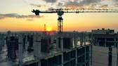 подниматься : Multistory houses are being constructed at sunset Стоковые видеозаписи