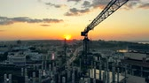 keretében : Construction site at a sunset. Urban building site and cranes an the sunset cityscape Stock mozgókép